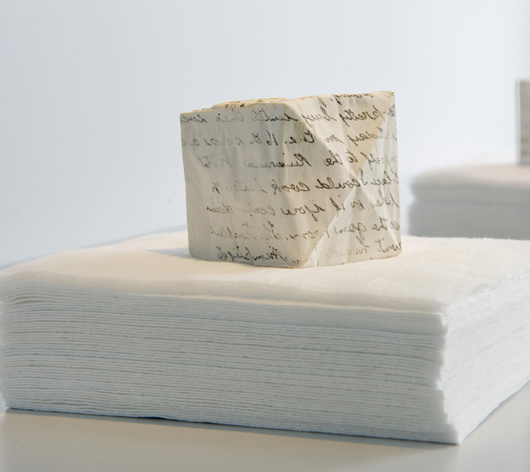 Dierdre Pearce, longing (detail), 2011. Shell cast plaster imprinted with found text, cotton gauze. Photograph Andrew Sikorski. Photograph courtesy of CraftACT.