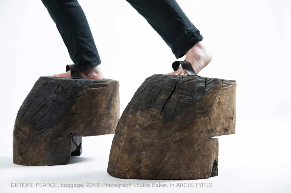 Dierdre Pearce, baggage, 2013. Carved fallen timber, leather and steel. Performance assisted by Llewellyn McGarry. Photograph Louise Baker.